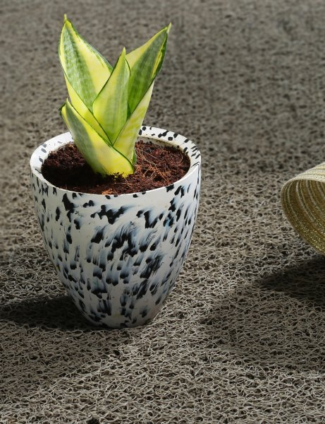 White recycled plastic planter with black spots